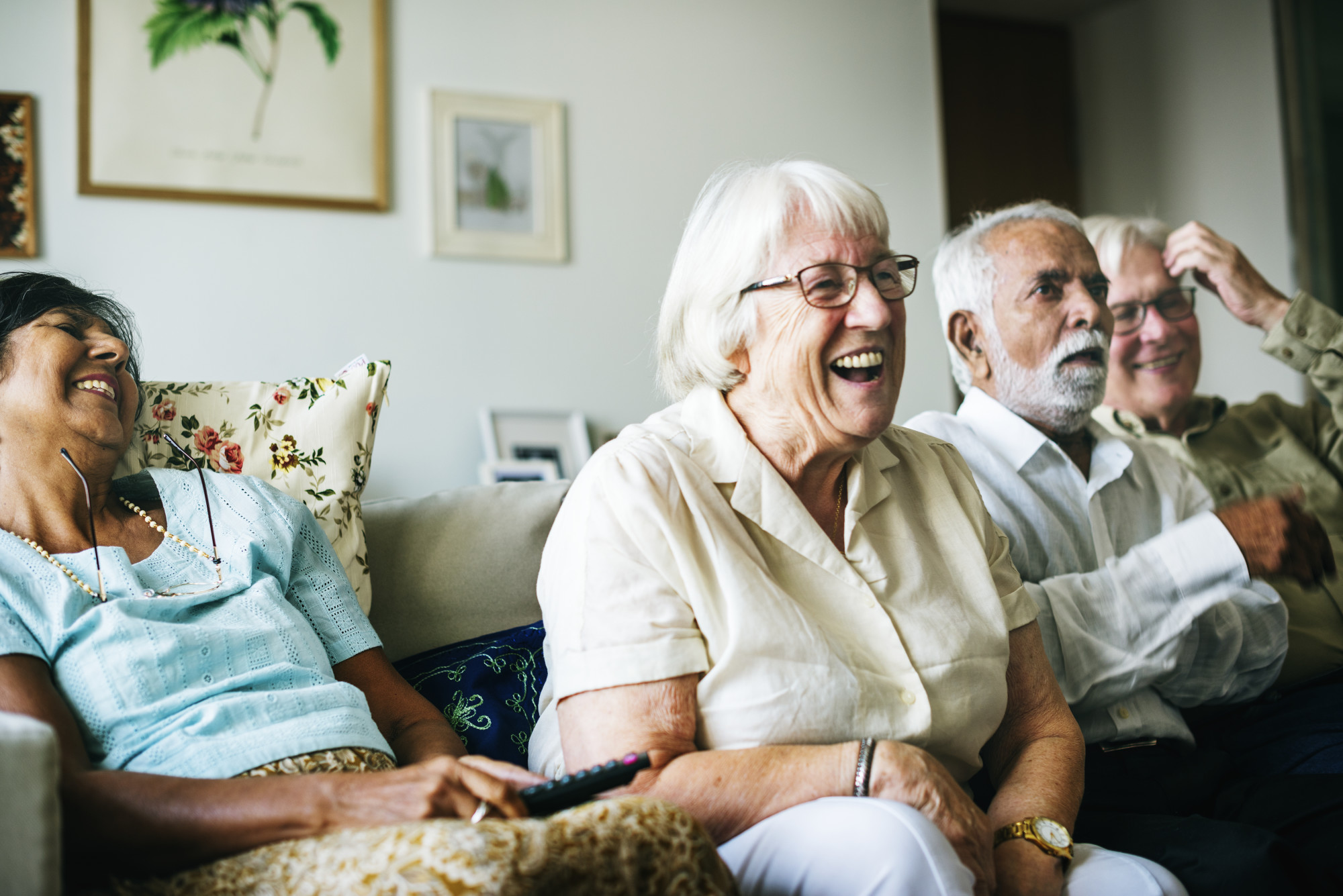 Elderly friends laughing